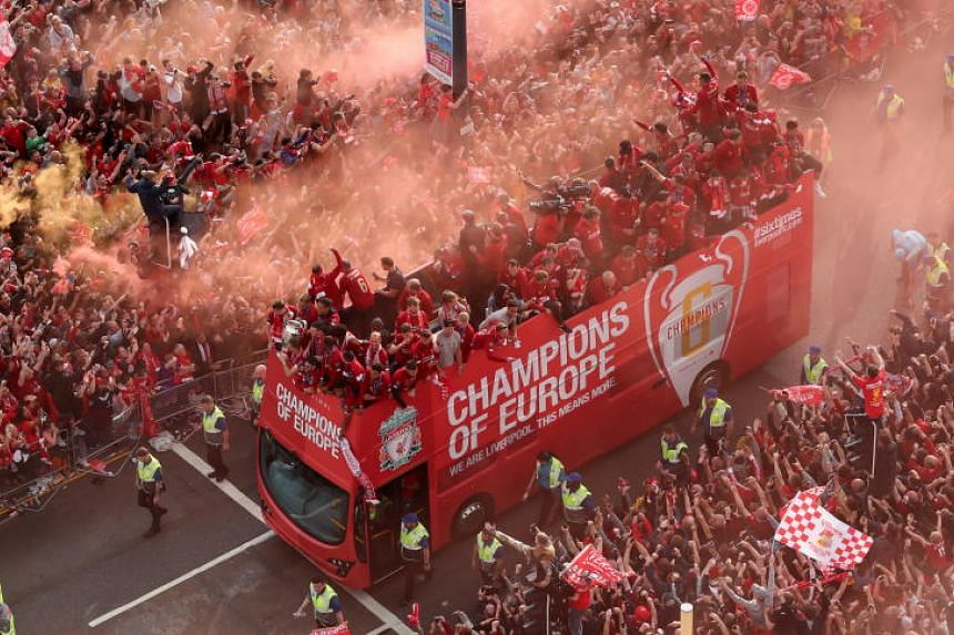 Liverpool supporters greet the team during the Liverpool victory parade in Liverpool on June 2, 2019.