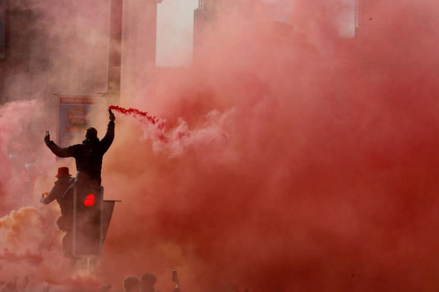 A Liverpool fan with a flare during the victory parade in Liverpool on June 2, 2019.