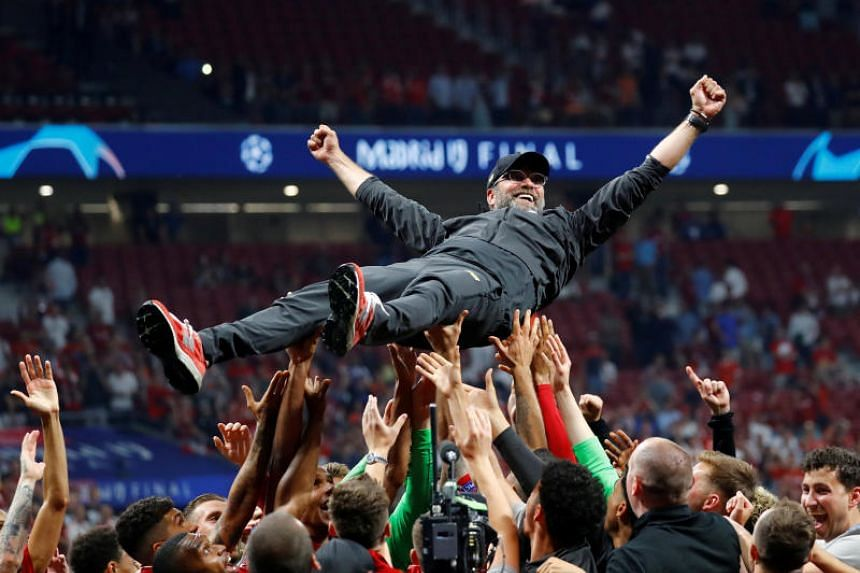 Liverpool manager Jurgen Klopp is thrown in the air by the players as they celebrate after winning the Champions League on June 1, 2019.