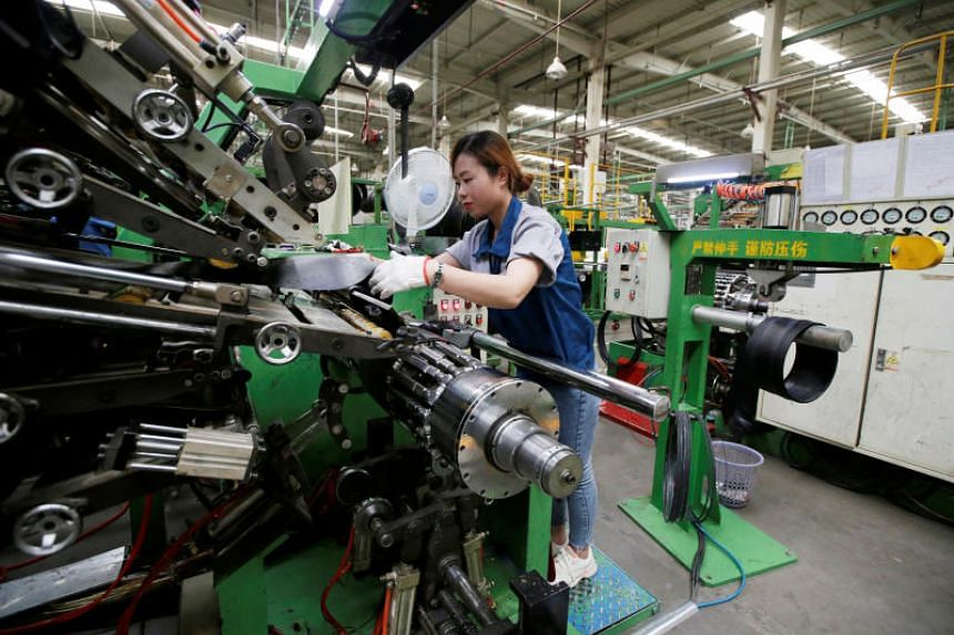 An employee works on the production line of a tyre factory in China under Tianjin Wanda Tyre Group, which exports its products to countries such as Japan, on May 21, 2019.
