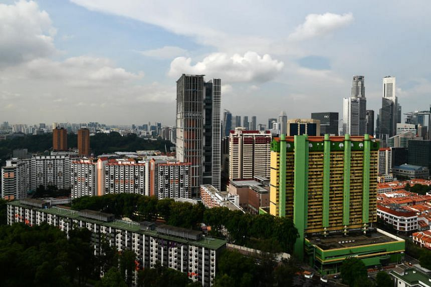 A view of the new State Courts Towers, People's Park Complex, and Chinatown from Pearl Bank Apartments.