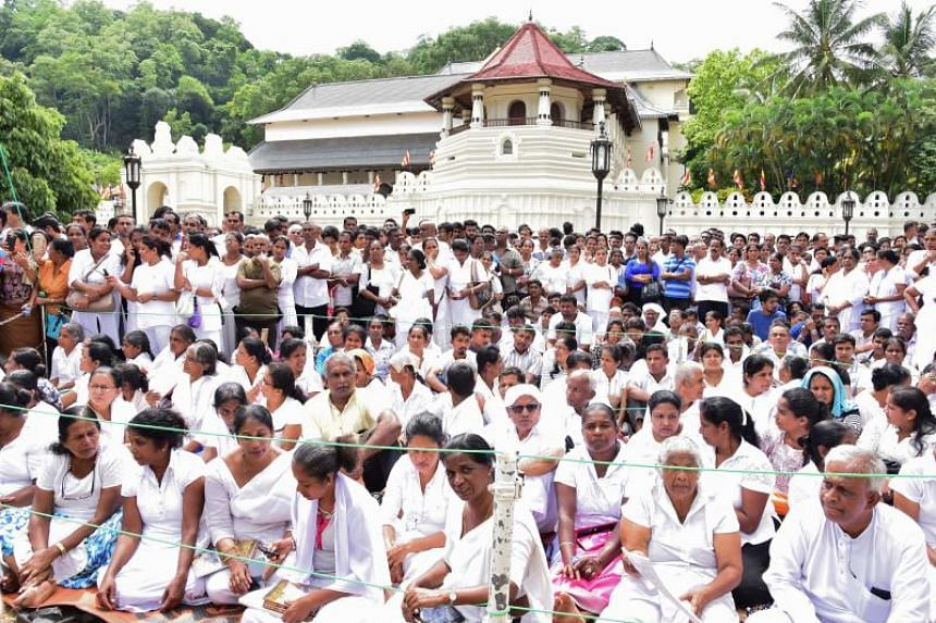 Activists demonstrate outside the Buddhist shrine Temple of the Tooth in the central town of Kandy, Sri Lanka, on June 3, 2019.