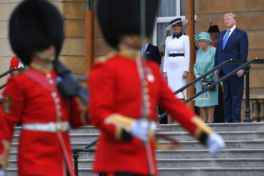 (From left) US First Lady Melania Trump, Britain's Queen Elizabeth II and US President Donald Trump watch an honour guard during a welcome ceremony at Buckingham Palace in central London on June 3, 2019.