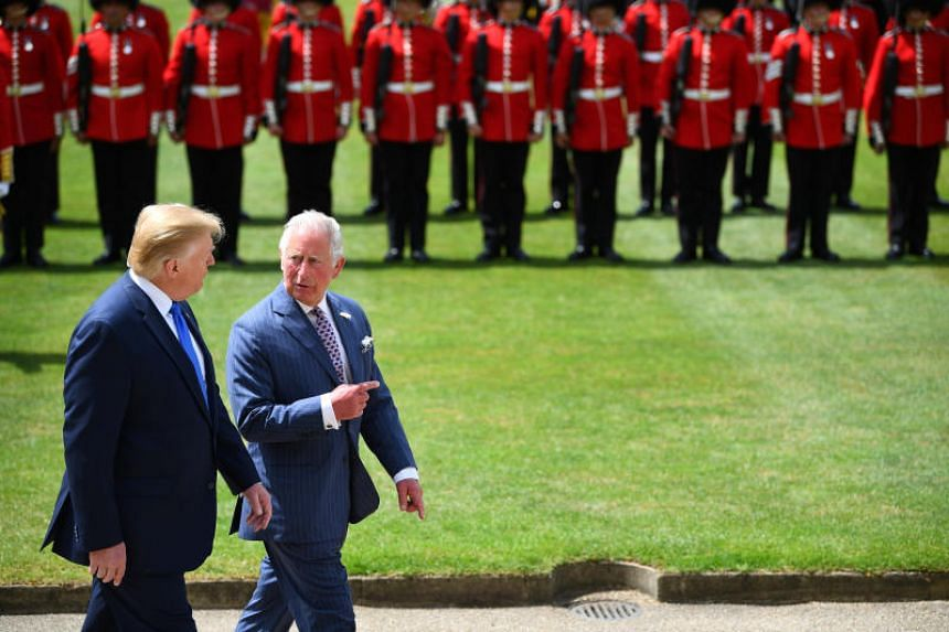 US President Donald Trump and Britain's Prince Charles inspect the Guard of Honour during the Ceremonial Welcome at Buckingham Palace, in London on June 3, 2019.