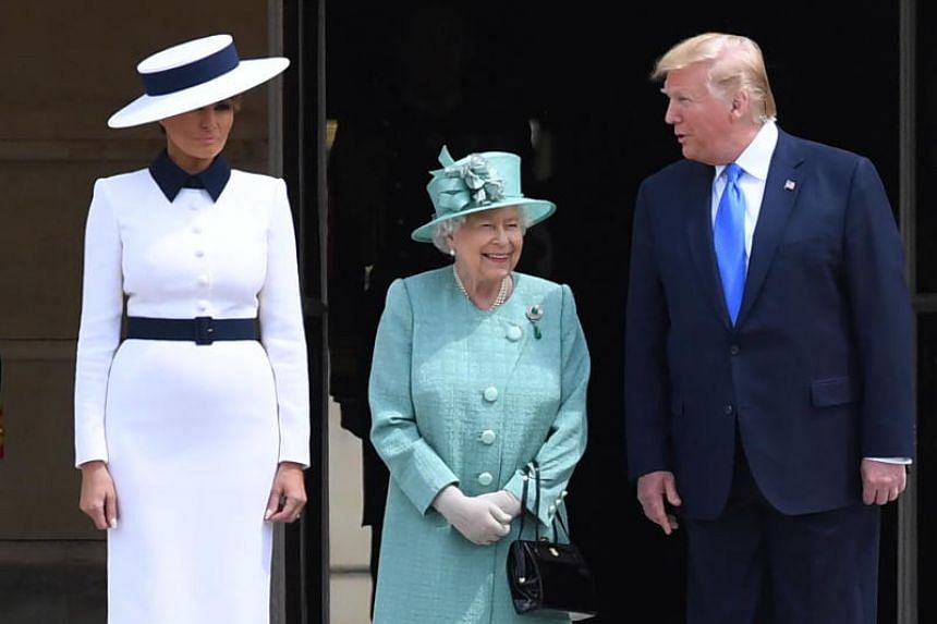 US President Donald Trump and his wife Melania Trump are welcomed by Britain's Queen Elizabeth II during the Ceremonial Welcome at Buckingham Palace in London on June 3, 2019.
