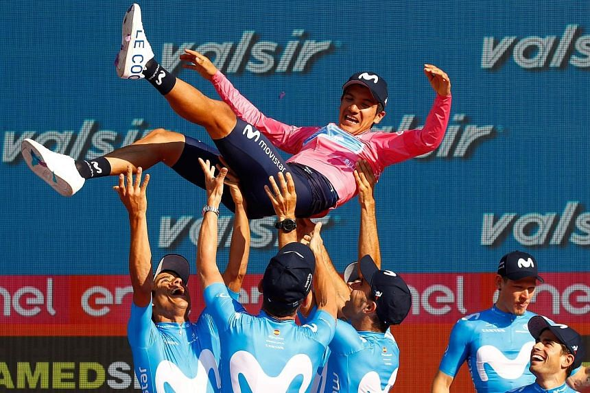 Cyclist Richard Carapaz celebrating his win at the Giro d'Italia race on Sunday. He is the first Ecuadorean to win the event. PHOTO: AGENCE FRANCE-PRESSE