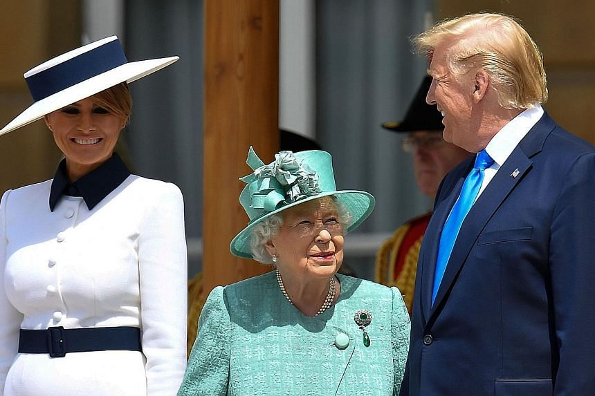 Britain's Queen Elizabeth received Mr Trump and his wife on the west terrace of Buckingham Palace. Other members of the royal family were also present to meet the US President and First Lady.