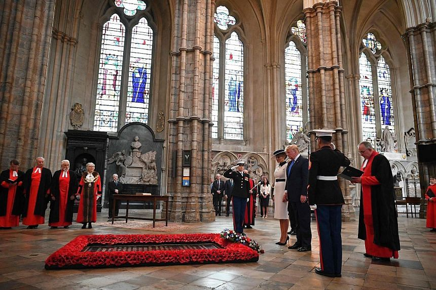 US President Donald Trump and First Lady Melania Trump laid a wreath on the tomb of the Unknown Warrior in Westminster Abbey yesterday, the first day of their visit to Britain.