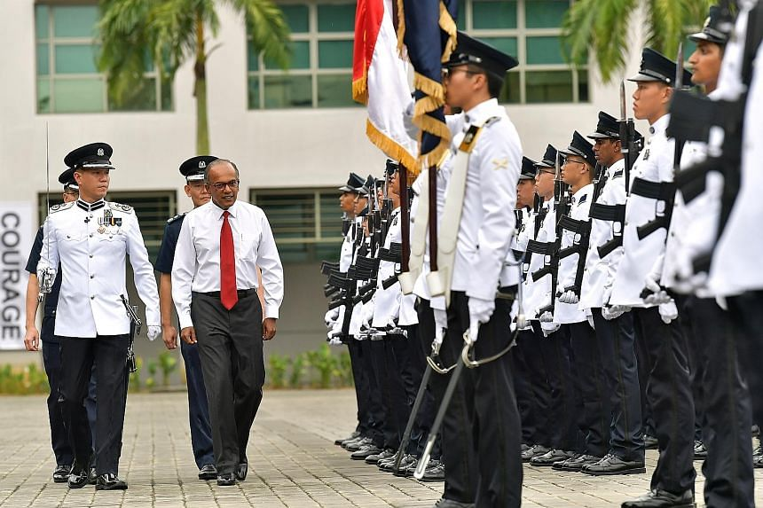 Above: Clementi Police Division commander Jarrod Pereira (left) and Jurong Police Division's NS commander Teo Chai Jing lead two of the award winners. Right: Home Affairs and Law Minister K. Shanmugam was guest of honour at the Police Day Parade 2019