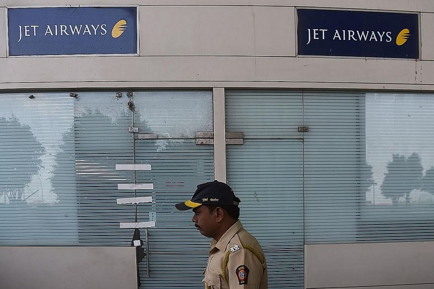 A closed Jet Airways office at Chhatrapati Shivaji Maharaj International Airport in Mumbai. Jet Airways, which halted operations in April after running out of cash, had a market share of about 12 per cent on international flights to and from India la