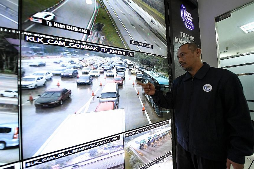 Malaysian Highway Authority officer Kamarudin Moktah showing the slow flow of traffic from a CCTV at the Gombak toll booth yesterday, two days before Hari Raya. The highway links the Malaysian capital Kuala Lumpur to the east coast states of Pahang,
