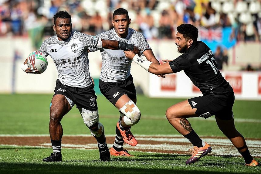 Fiji's Jerry Tuwai (left) is pursued by Ngarohi McGarvey Black of New Zealand during the Paris Sevens final. PHOTO: AGENCE FRANCE-PRESSE