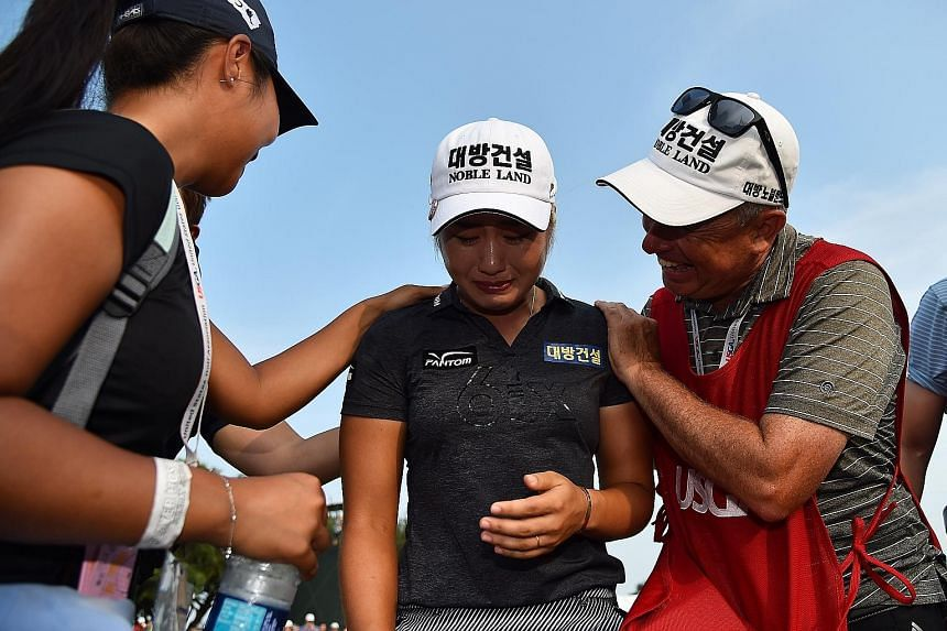 Lee6 Jeong-eun, with caddie Adam Woodward, shedding tears of joy after winning the US Women's Open and the purse of US$1 million at the Country Club of Charleston on Sunday. PHOTO: REUTERS