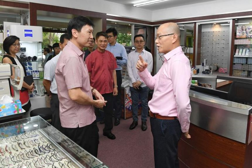 Senior Minister of State for Trade and Industry Chee Hong Tat with Mr Jonathan Wong, senior optometrist at Logos Eyecare, during a visit to heartland enterprises at Ang Mo Kio Town Centre on June 4, 2019.