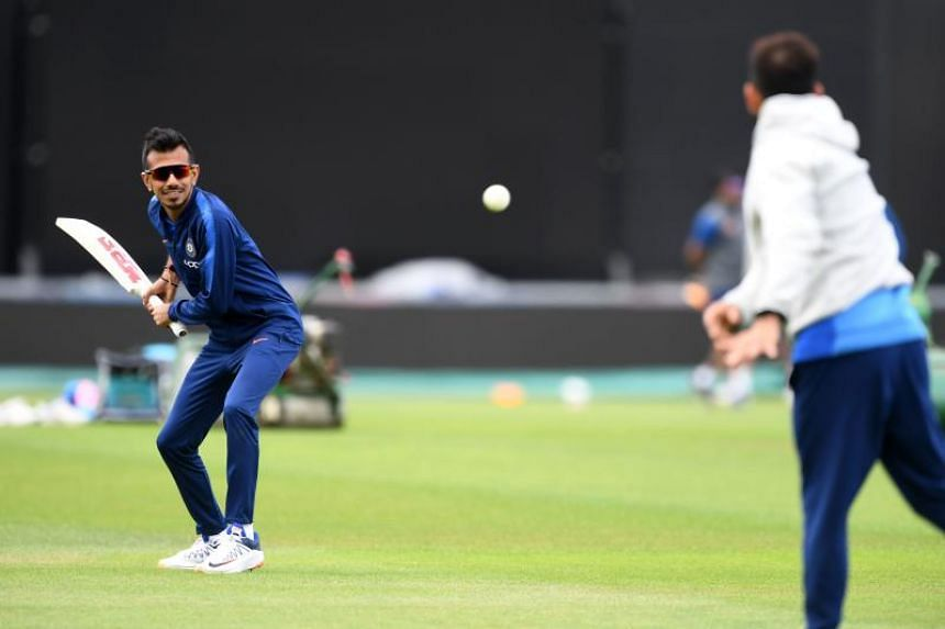 India's captain Virat Kohli (right) bowls to teammate Yuzvendra Chahal during a training session at the Rose Bowl in Southampton, England, on June 3, 2019.