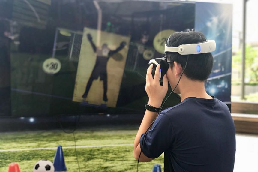 Take the whole family to play football—in VR mode—at Kallang Wave Mall. PHOTO: KALLANG WAVE MALL