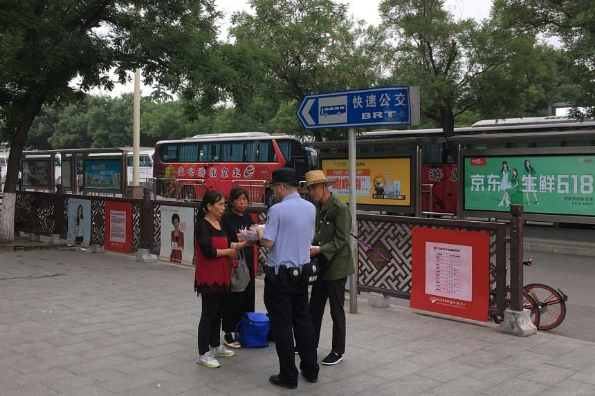 A police officer stops petitioners at the southern end of Tiananmen Square in Beijing, China on June 4, 2019.