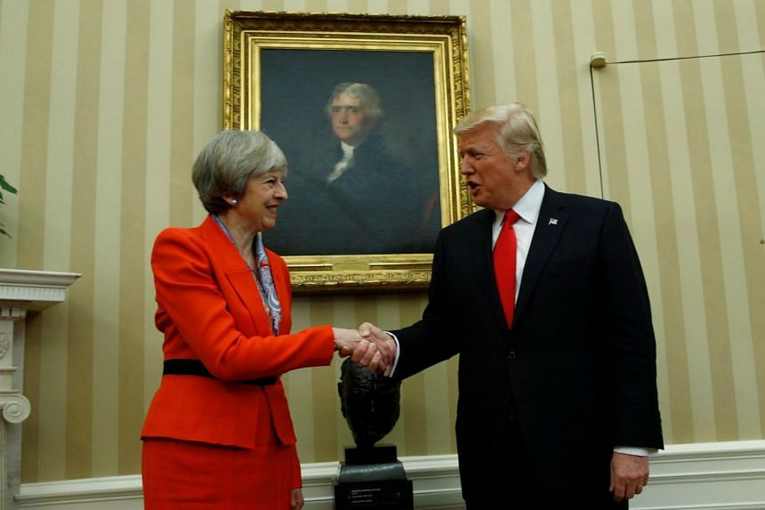 United States President Donald Trump shakes hands with British Prime Theresa Minister May in the White House Oval Office in Washington, US, on January 27, 2017.