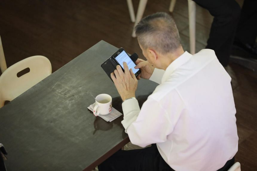 A man using his phone on Sept 20, 2018.