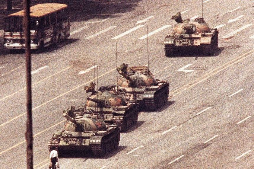 An unidentified man, who later became known as Tank Man, blocking a column of tanks in Beijing's Avenue of Eternal Peace on June 5, 1989.