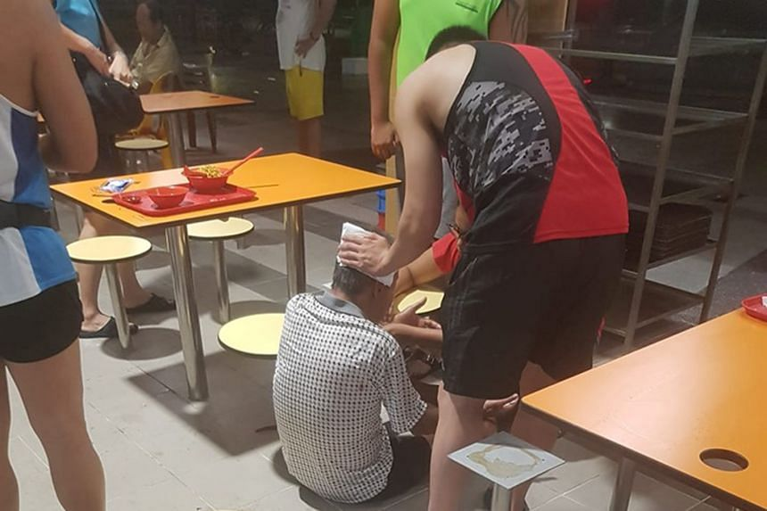 One of the images circulating online shows the elderly man on the floor of the Teck Ghee Square hawker centre and a younger man pressing what looks like a paper napkin to the back of his head.