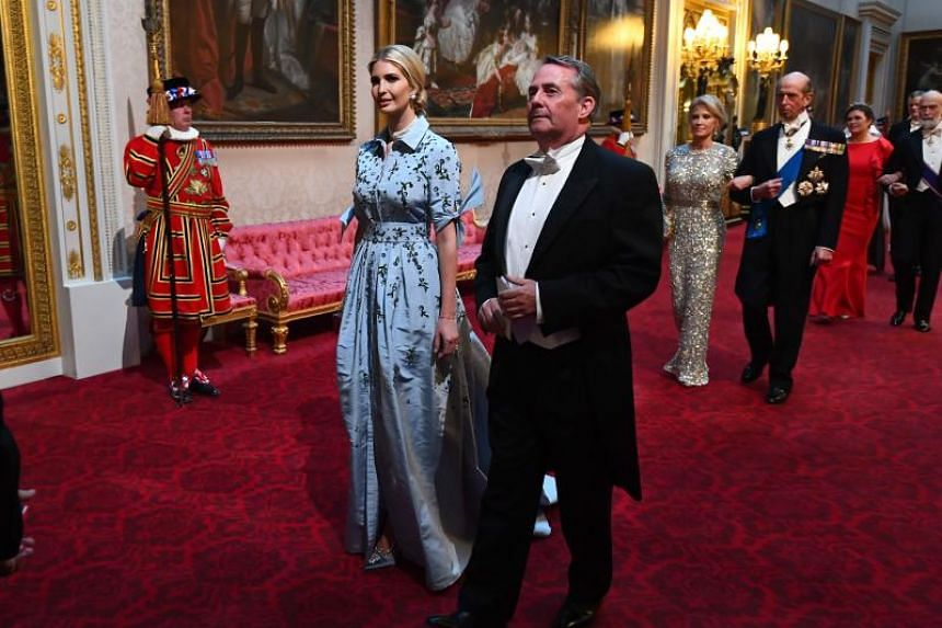 Ivanka Trump, daughter of US President Donald Trump, and Britain's International Trade Secretary Liam Fox arrive at the state banquet at Buckingham Palace on June 3, 2019.