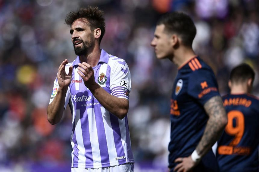 Real Valladolid's Spanish midfielder Borja Fernandez applauds during the Spanish league football match between Real Valladolid FC and Valencia CF on May 18, 2019.