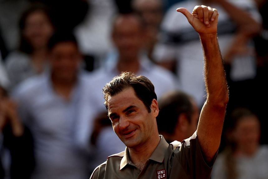 Federer reacts after winning against Stan Wawrinka of Switzerland.