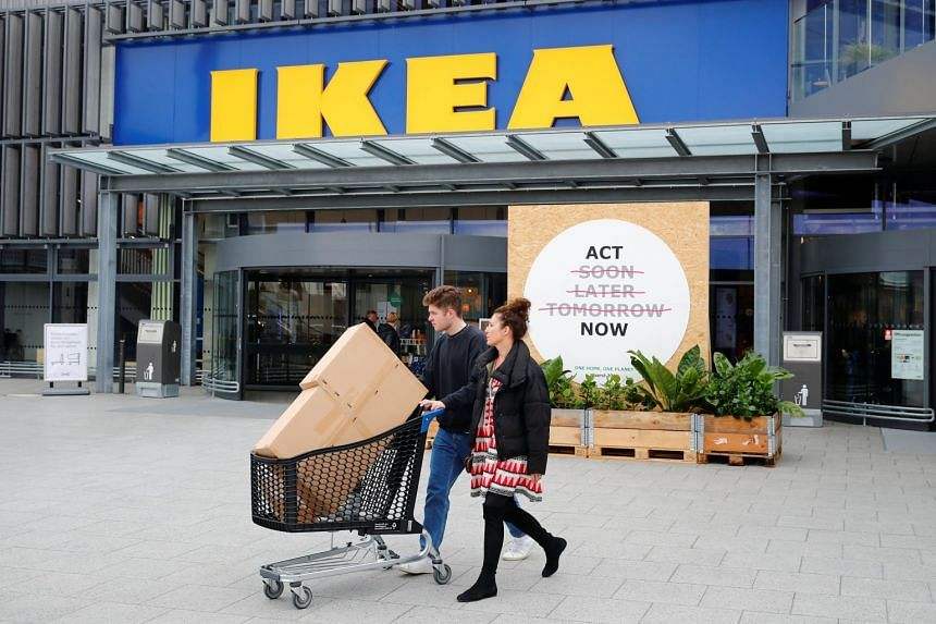 Customers leave an IKEA store in Kaarst near Duesseldorf, Germany.
