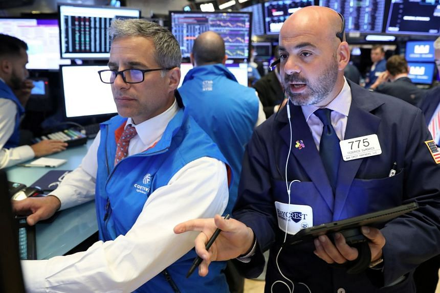 Traders work on the floor at the New York Stock Exchange, June 3, 2019.