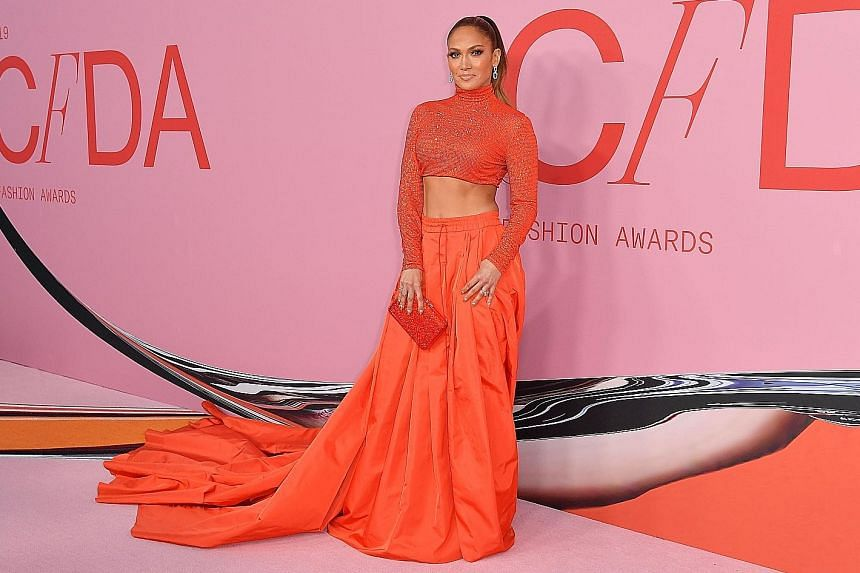 """STYLE STAR: There are """"icons, but there is only one Jennifer Lopez"""", the singer's fiance Alex Rodriguez posted, along with a photo of the duo heading to a glamorous event on Monday in a limousine. The occasion was the Council of Fashion Designers of"""