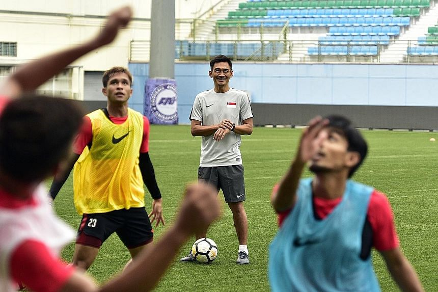 Singapore assistant coach Nazri Nasir with the Lions squad during training at Jalan Besar Stadium on Monday. He says his short stint as caretaker coach was a good learning experience.