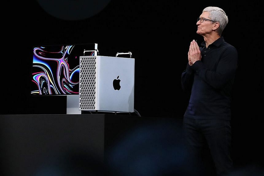 Apple CEO Tim Cook unveiling the new Mac Pro at the Worldwide Developers Conference on Monday. PHOTO: AGENCE FRANCE-PRESSE