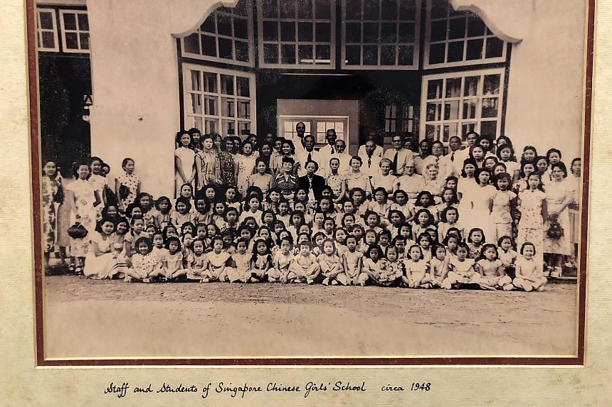 Above: An undated archive image of Singapore Chinese Girls' School staff and pupils outside the Primary School Block, which was completed in 1925. Below: Staff and students of SCGS, circa 1948.