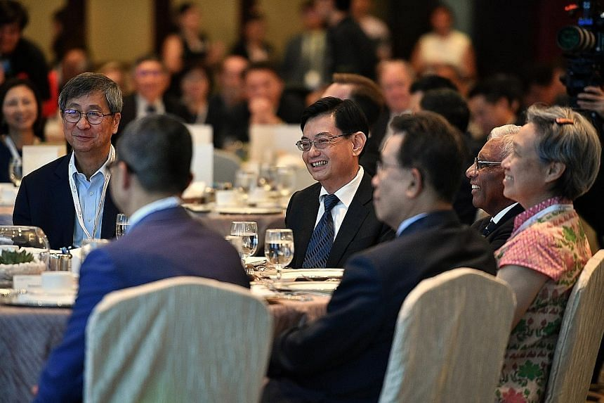 Temasek chairman Lim Boon Heng (from left), Deputy Prime Minister Heng Swee Keat, Temasek Trust board of trustees chairman and Council of Presidential Advisers member S. Dhanabalan, and Temasek executive director and chief executive Ho Ching at the S