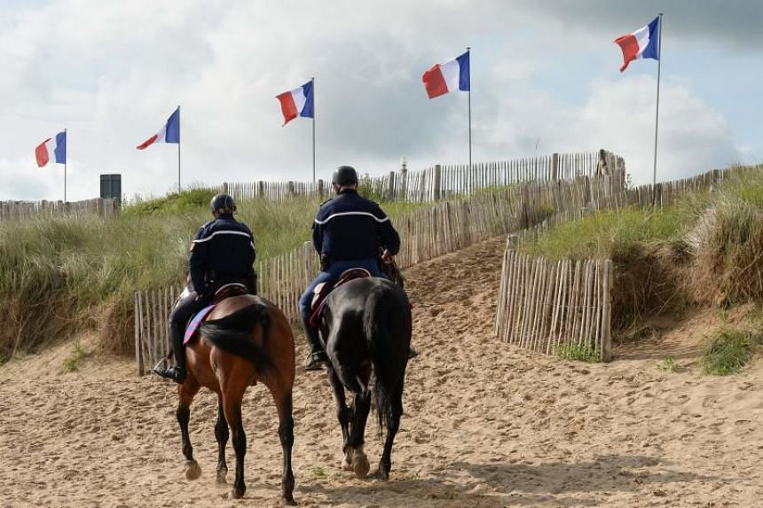 French Mounted Republican Guards on Juno Beach in Courseulles-sur-Mer, north-western France, on June 5, 2019, during commemorations marking the 75th anniversary of the D-Day landings in Normandy.
