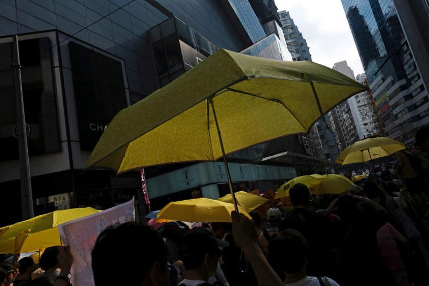 Demonstrators hold yellow umbrellas, the symbol of the 2014 Occupy Central movement, during a protest to demand authorities scrap a proposed extradition bill, in Hong Kong on April 28, 2019.
