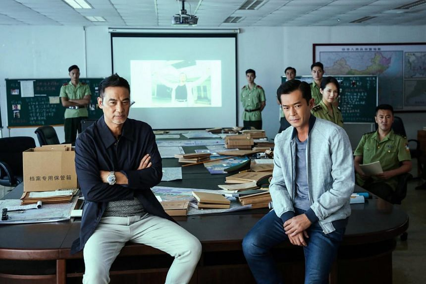 Louis Koo (right) humanises his character with some manly tears and also through his rapport with his superior/friend played by Simon Yam (left).