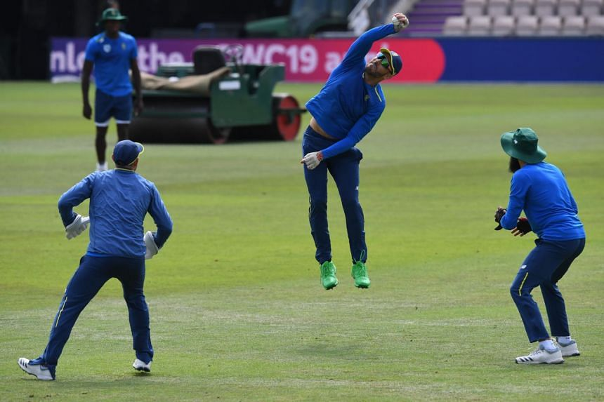 South Africa's captain Faf du Plessis (centre) fields during a training session at the Rose Bowl in Southampton, southern England, on June 4, 2019.