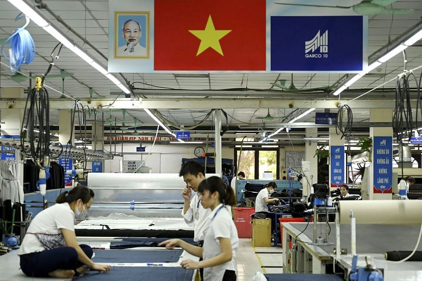Garment workers in a Hanoi factory. Vietnam has gained orders from trade diversion on tariffed goods equal to 7.9 per cent of gross domestic product in the year through the first quarter of 2019, says a study.