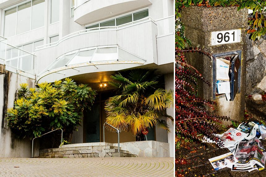 """The Vancouver mansion where Mr Yuan Gang was found murdered. The original house number """"963"""" has been covered with a sticker bearing the number """"961"""" to downplay the property's bloody history. According to court testimony, Zhao Li shot Mr Yuan twice,"""