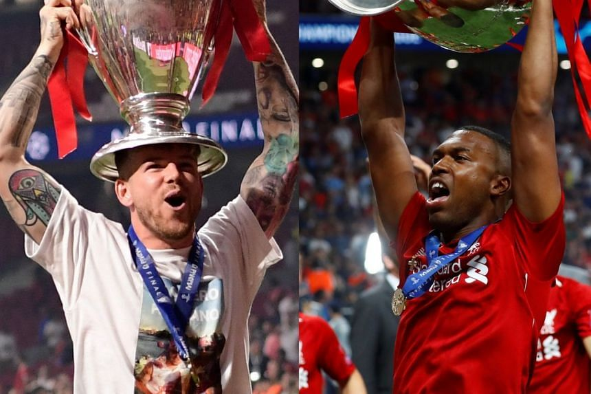 Moreno (left) and Sturridge celebrate with the trophy after Liverpool won the Champions League.