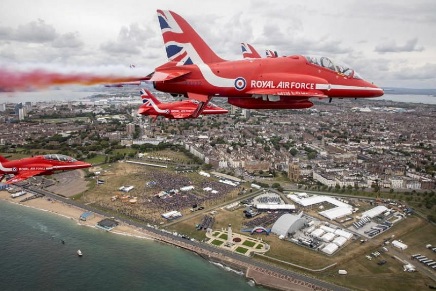 A flypast by the British Royal Air Force Aerobatic Team during commemorations for the 75th anniversary of D-Day on June 5, 2019.