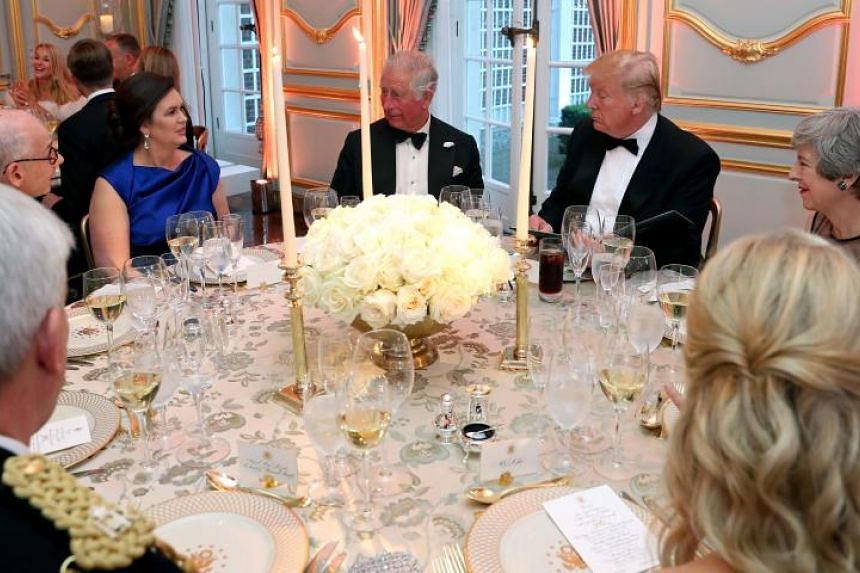 US President Donald Trump and Britain's Prince Charles, joined by White House Press Secretary Sarah Huckabee Sanders and British Prime Miinister Theresa May, at a dinner at Winfield House in London on June 5, 2019.