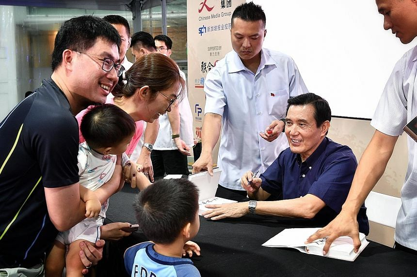 Former president Ma Ying-jeou from Taiwan signing copies of his biography, Memoirs Of My Eight-Year Presidency: 2008 to 2016, at the Singapore Book Fair, at Capitol Singapore, yesterday. The book was a bestseller in Taiwan when it was released last D