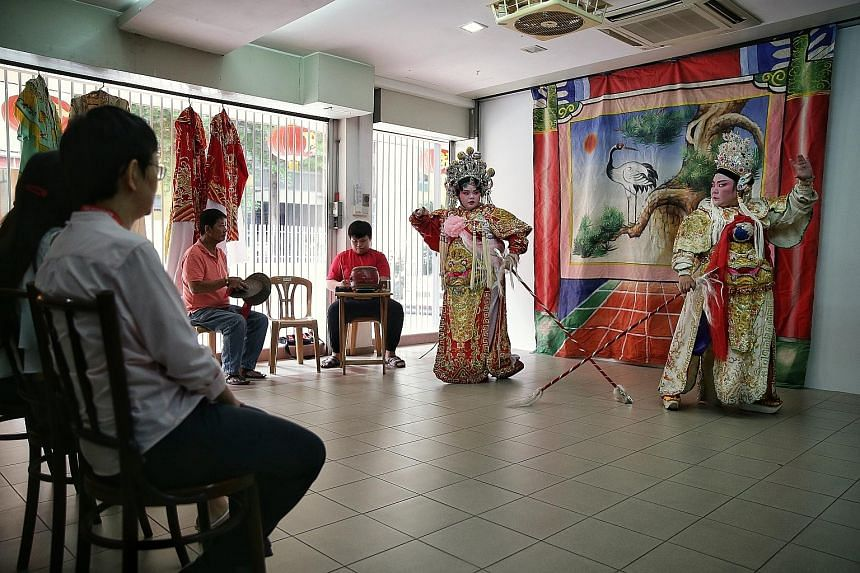 Sin Ee Lye Heng Teochew Opera's Ms Tina Quek (far right), 50, and daughter Christine Ang, 21, performing for participants of a heritage tour organised by Xperience Singapore recently. Such tours are evolving from just taking people to visit places to