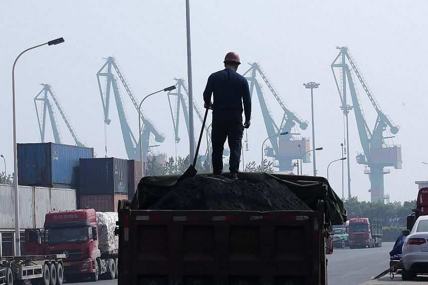 A coal truck outside a logistics centre near Tianjin Port. China's Ministry of Finance last week posted a list of imports from the US for which tariff waivers could be granted; the items include meats such as beef and pork, soya beans, coal and coppe