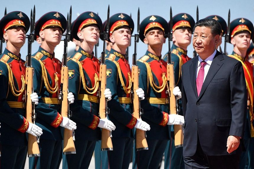 Chinese President Xi Jinping inspecting a Russian guard of honour during a welcome ceremony upon his arrival at Moscow's Vnukovo airport yesterday. His state visit to Russia highlights a deepening partnership between the two countries as both face gr