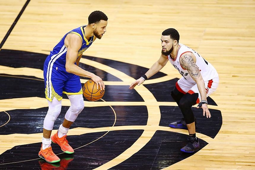 The Warriors' Stephen Curry is defended by the Raptors' Fred VanVleet as part of a box-and-one strategy in Game Two in Ontario, Canada.