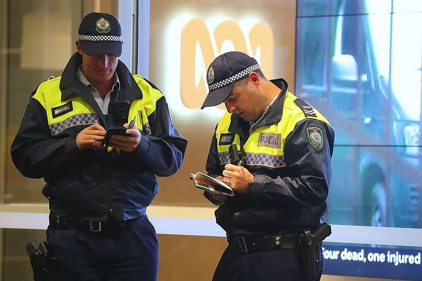Policemen outside the ABC building in Sydney yesterday. The broadcaster was raided over claims that it had published classified material. PHOTO: EPA-EFE